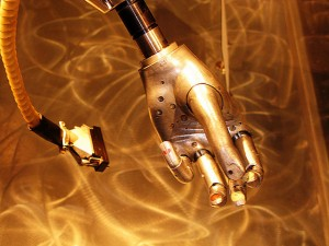 robot robotic hand gold AI artificial intelligence connected internet of things wired