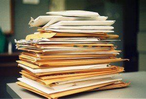 stack of files and envelopes