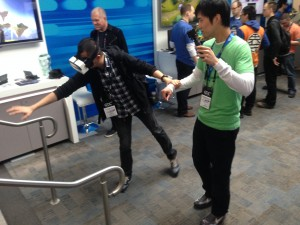 A GDC attendee tries out the headset and reaches for a virtual statue