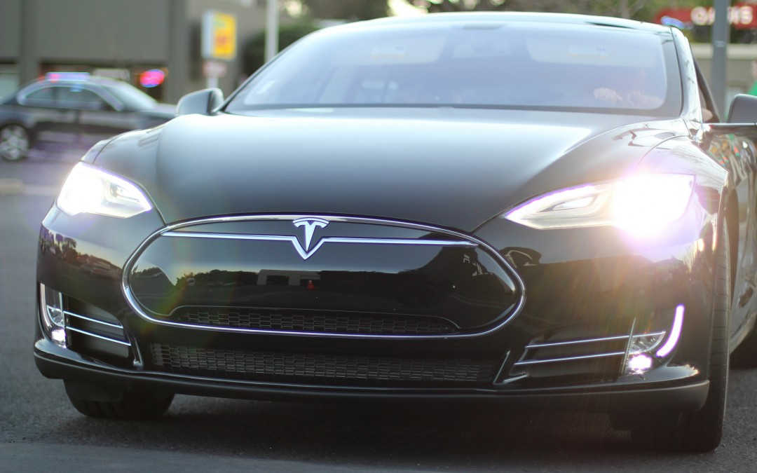 Tesla earns surprise profit thanks to reduced costs, higher vehicle sales